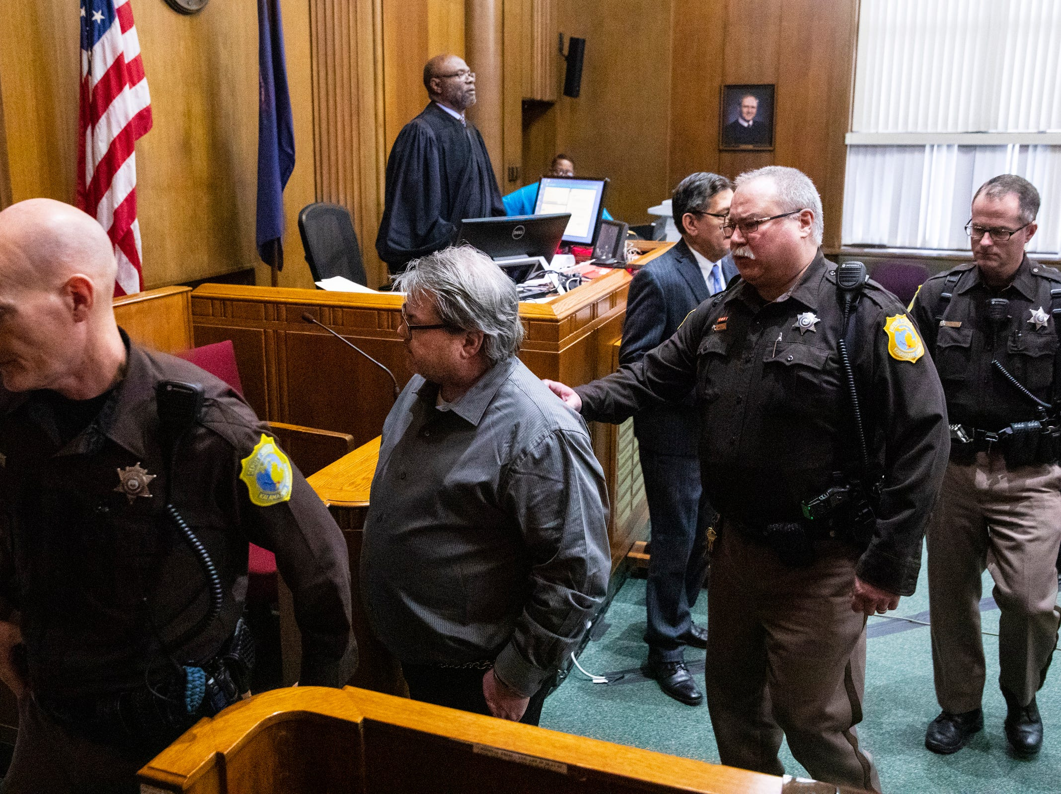 Jason Dalton is led out of the court room after he plead guilty to six counts of murder and several other charges at the Kalamazoo County Courthouse on Monday, Jan. 7, 2019 in Kalamazoo, Michigan.  Dalton, who was driving for Uber at the time shot eight people killing six of them, on Saturday, Feb. 20, 2016. Opening statements in the trial were scheduled to begin Tuesday, Jan. 8. (Joel Bissell | MLive.com)