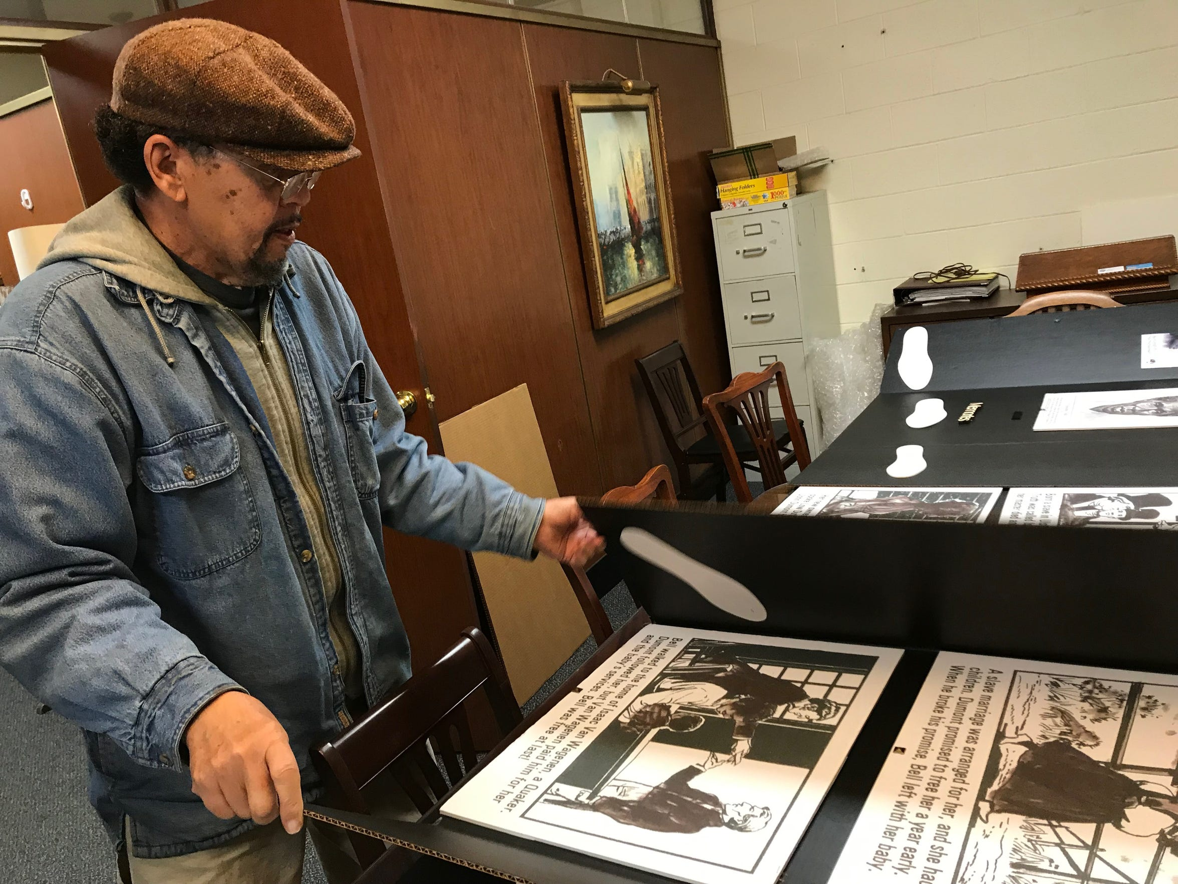 Thomas McLiechey lays out a timeline display he created to provide a visual aid for young people learning about Sojourner Truth.