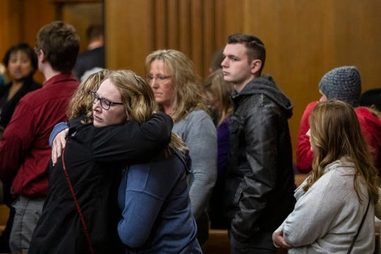 Family members of victims hug one another after Jason Dalton plead guilty to six counts of murder and several other charges at the Kalamazoo County Courthouse on Monday, Jan. 7, 2019 in Kalamazoo, Michigan.  Dalton, who was driving for Uber at the time shot eight people killing six of them, on Saturday, Feb. 20, 2016. Opening statements in the trial were scheduled to begin Tuesday, Jan. 8. (Joel Bissell | MLive.com)