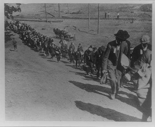 This September 1917 photos shows the first draft contingent arriving at Camp Custer — the Army training camp carved out of the rolling countryside chosen by Spiritualists before the Civil War for a Utopian village named Harmonia.