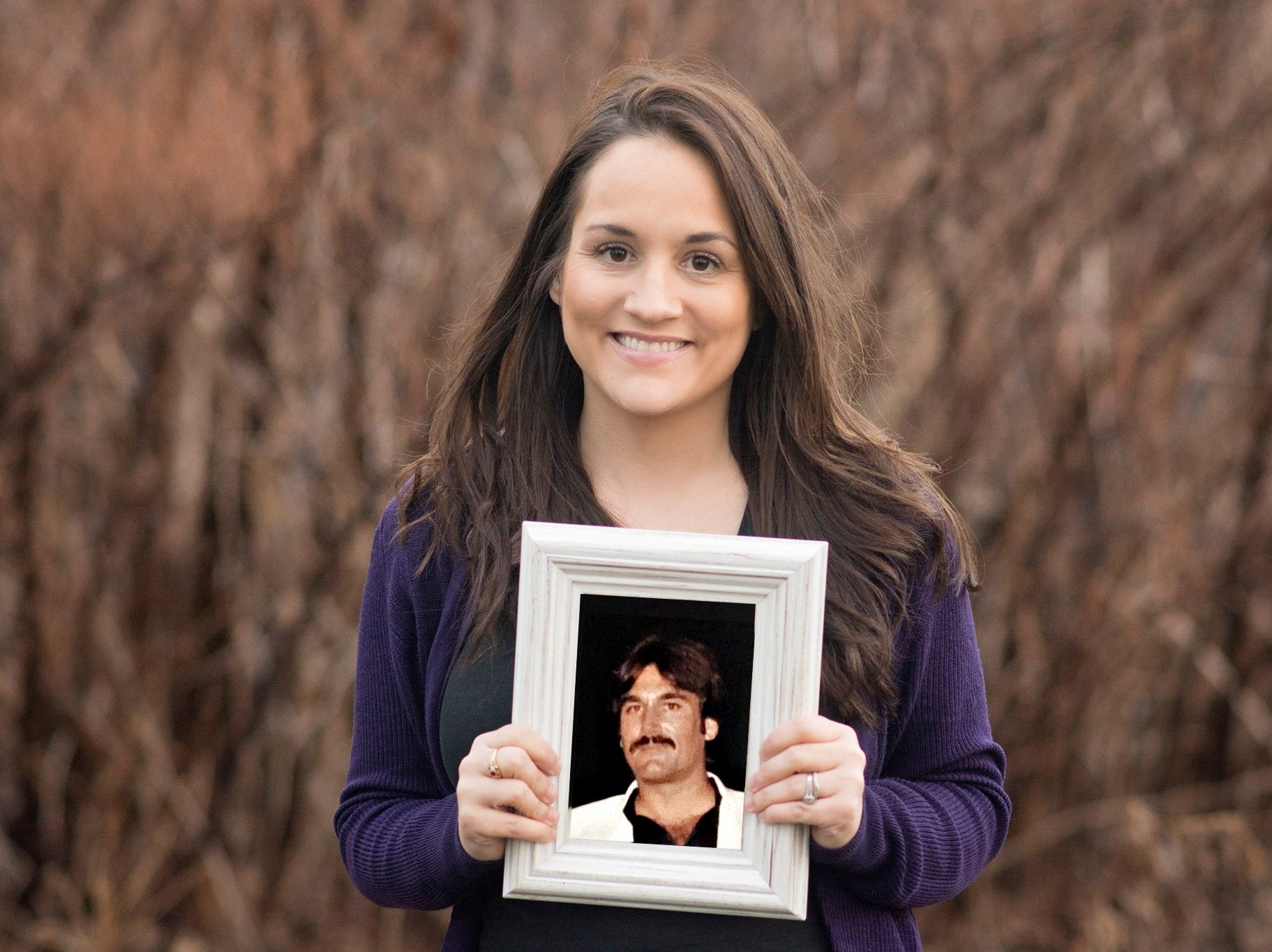 Mindi Prince holds a photo of her father, who died before she was a year old.