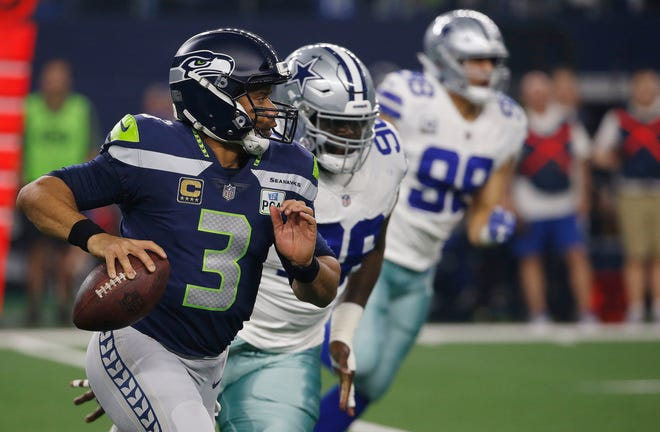 Seahawks quarterback Russell Wilson threw for 233 yards and a touchdown in Saturday's playoff loss to the Cowboys. Many fans have wondered if Seattle's coaches should have allowed Wilson to throw more after the running game was stymied.