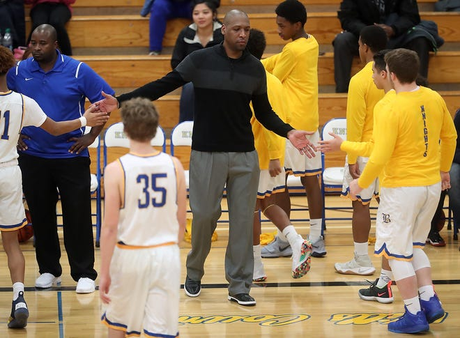 Deforrest Phelps was a star for the Bremerton Knights in the early 1990s. Now he's an assistant coach, giving back to the community where he grew up.