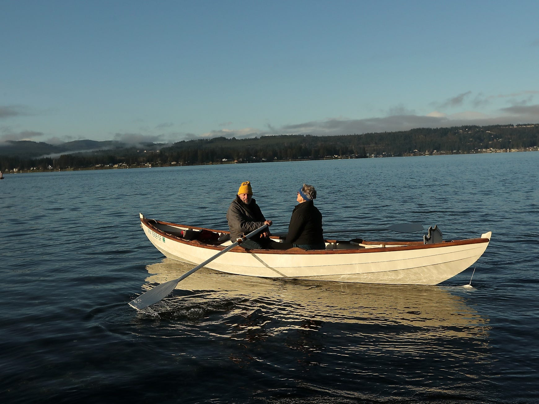 Rich Hladky and Heather McHugh take advantage of the morning sunshine and head out for a paddle in Hladky's row boat, at the Tracyton boat launch on Monday, January 7, 2019.