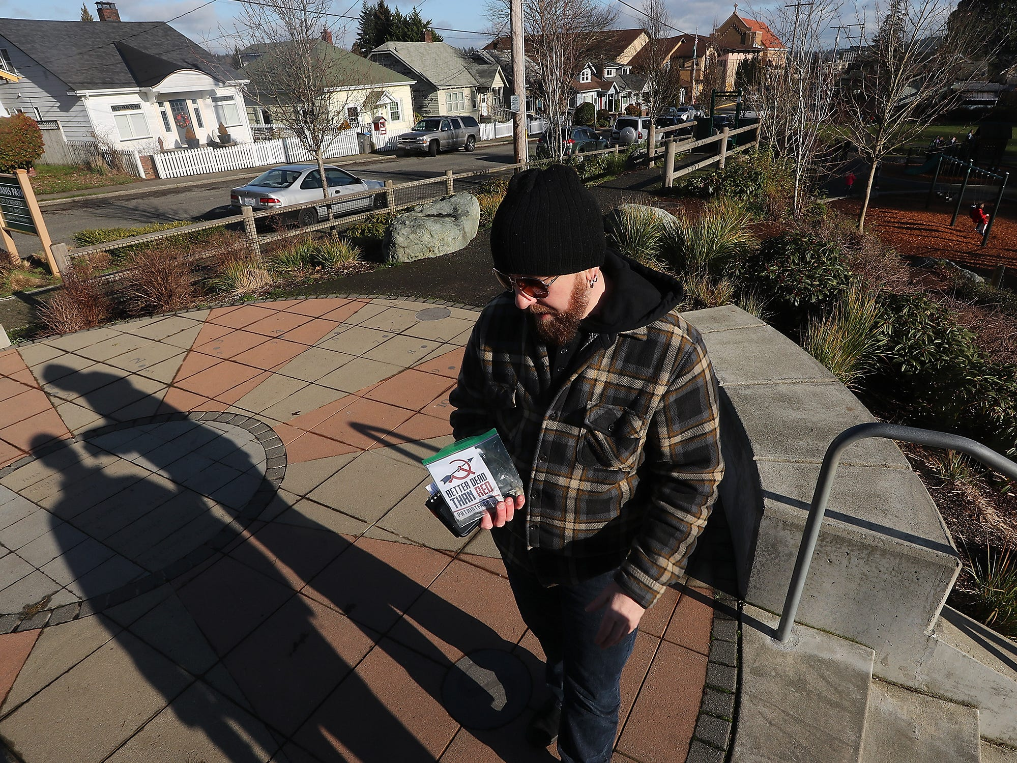 Airen Lydick holds one of the flyers that he collected that was tossed into yards of those living in the Union Hill neighborhood in Bremerton, on Monday, January 7, 2019.