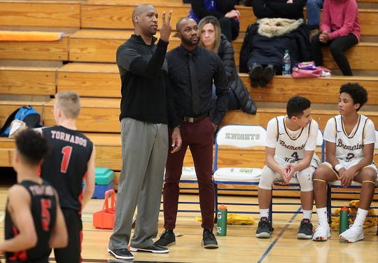 Deforrest Phelps (left) and Miah Davis both led Bremerton High to state basketball tournament runs as players. Now they're teaming up to coach the young Knights.