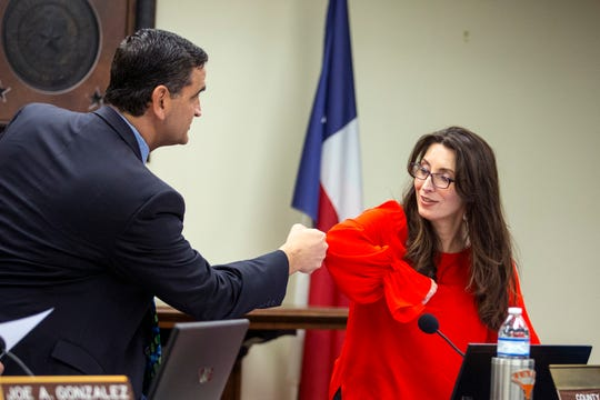 Nueces County Commissioner Brent Chesney gets an elbow pump from County Judge Barbara Canales at her first commissioner's court meeting on Monday, January 7, 2019 at the Nueces County Courthouse. Canales was ill over the weekend, so avoided handshakes at her first meeting.