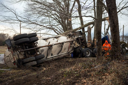Officials work the scene after a school bus carrying 22 students collided with a tractor-trailer Monday, Jan. 7, 2019 in South Harrison, N.J.
