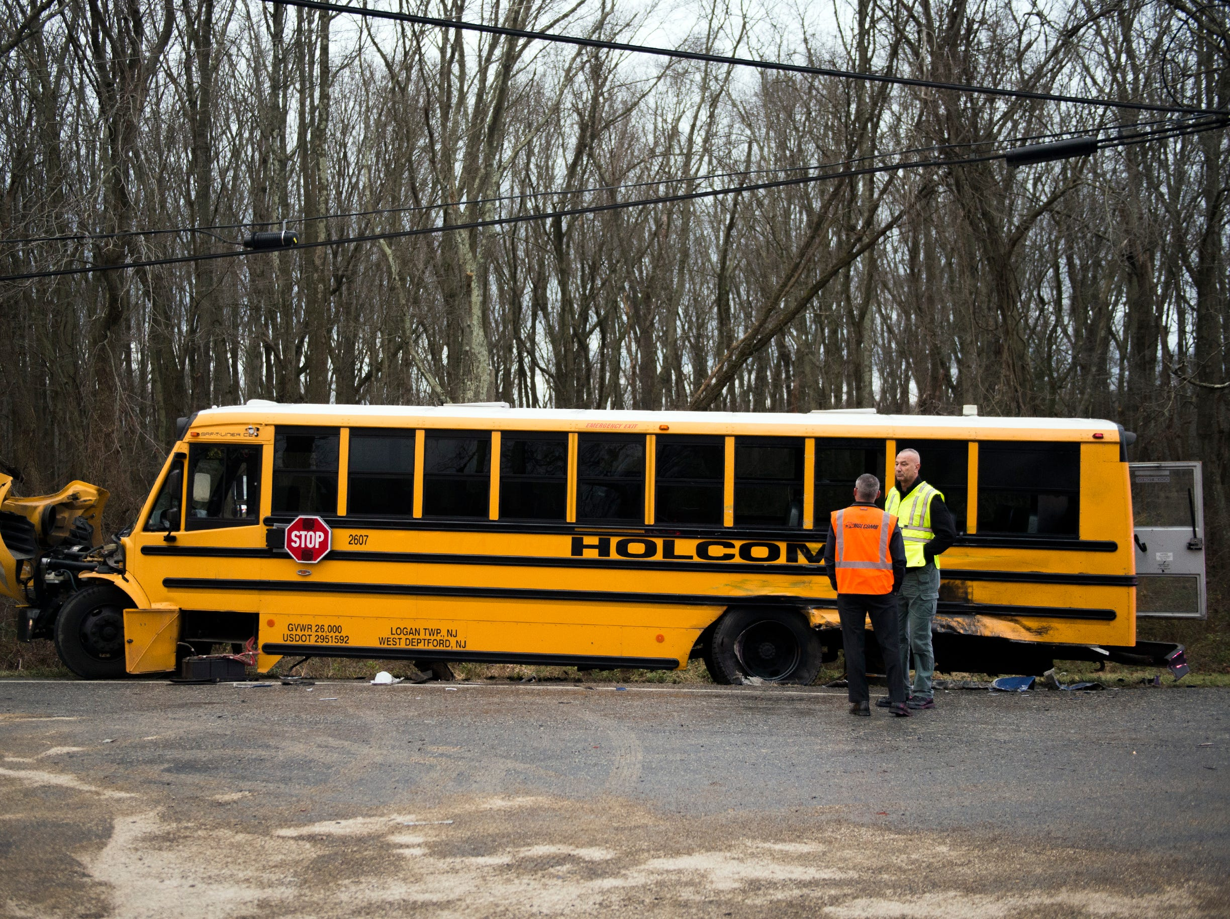 Officials work the scene after a school bus carrying 22 students collided with a tractor trailer Monday, Jan. 7, 2019 in South Harrison, N.J.