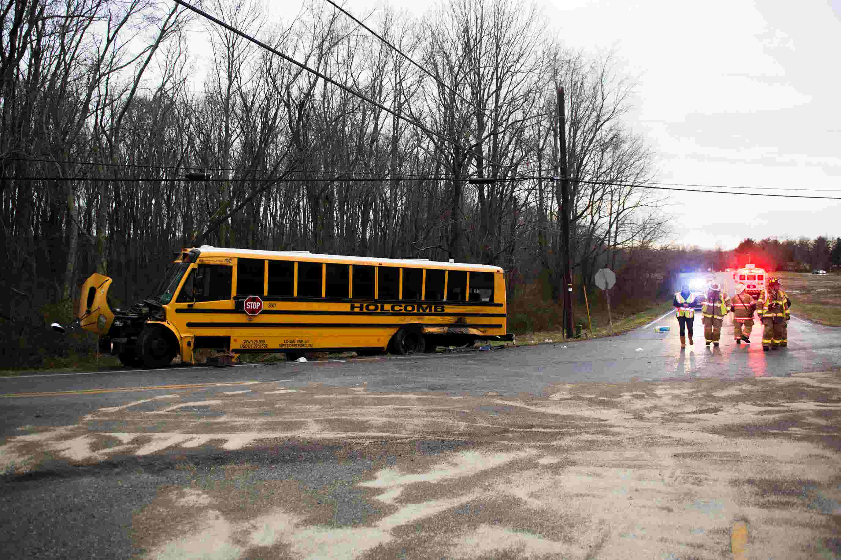 WATCH: Officials work a scene following collision between school bus and  tractor-trailer