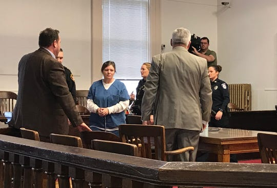 Angela Wagner is led into the Pike County Courtroom for her first pretrial hearing on Jan. 7, 2018. Wagner, her husband, and two sons face eight capital murder charges related to the April 2016 shooting deaths of eight members of the Rhoden family.