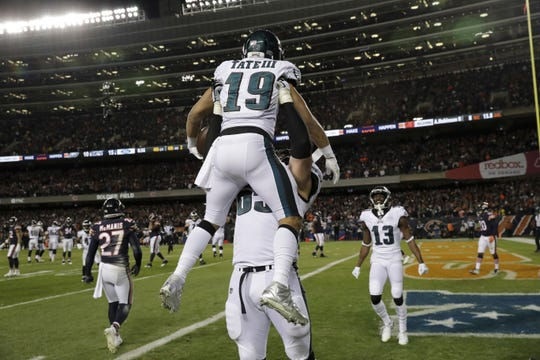 Philadelphia Eagles wide receiver Golden Tate (19) celebrates his touchdown reception with offensive tackle Lane Johnson (65) during the second half of an NFL wild-card playoff football game against the Chicago Bears Sunday, Jan. 6, 2019, in Chicago.