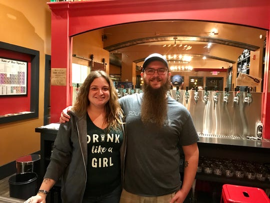 The government shutdown may force Sara and Gus Stathes to postpone some events at their Barrel House bar in Dayton due to delays in approval for new varieties of beer.