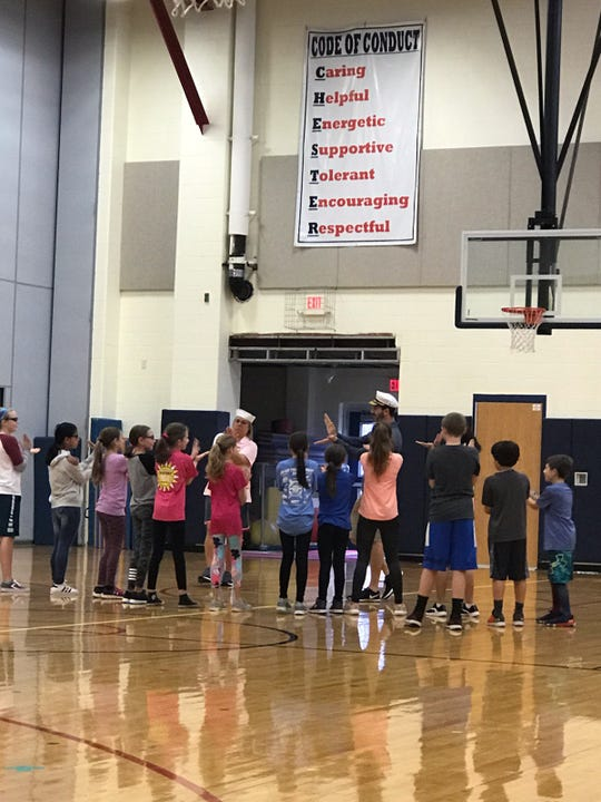 Laura Lamson and John Tsihlas teaching grade 5 students the game Shipwreck during PE Jam at Dickerson Elementary School in Chester.