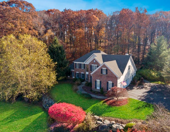 A 1.5-acre lot bordering parkland is the setting for a brick front Colonial in The Woods at Fox Farm which is listed for $499,900.