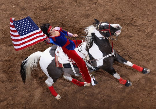 A cowgirl performs at the World's Toughest Rodeo in 2009 in Glendale, Ariz.