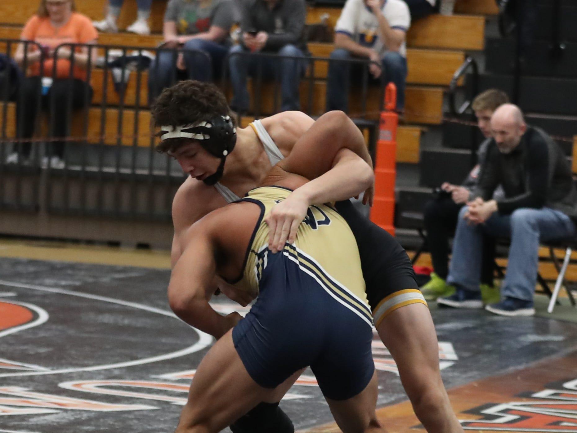Cade DeVos ,of Southeast Polk High, wrestles at the Cheesehead Invitational at Kaukauna High School in Kaukauna, Wisconsin, on Jan. 5, 2019.
