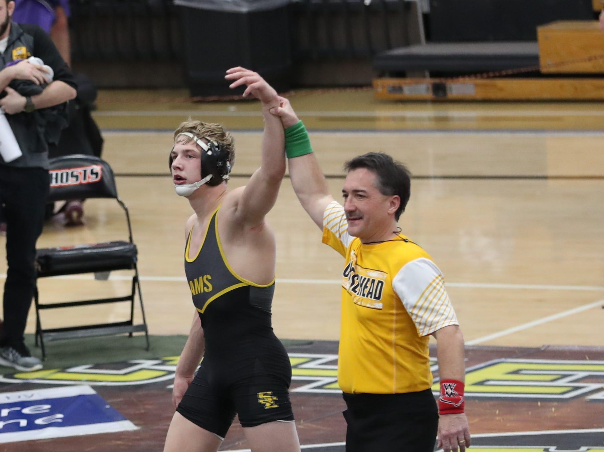 Lance Runyon, of Southeast Polk High, wrestles at the Cheesehead Invitational at Kaukauna High School in Kaukauna, Wisconsin, on Jan. 5, 2019.