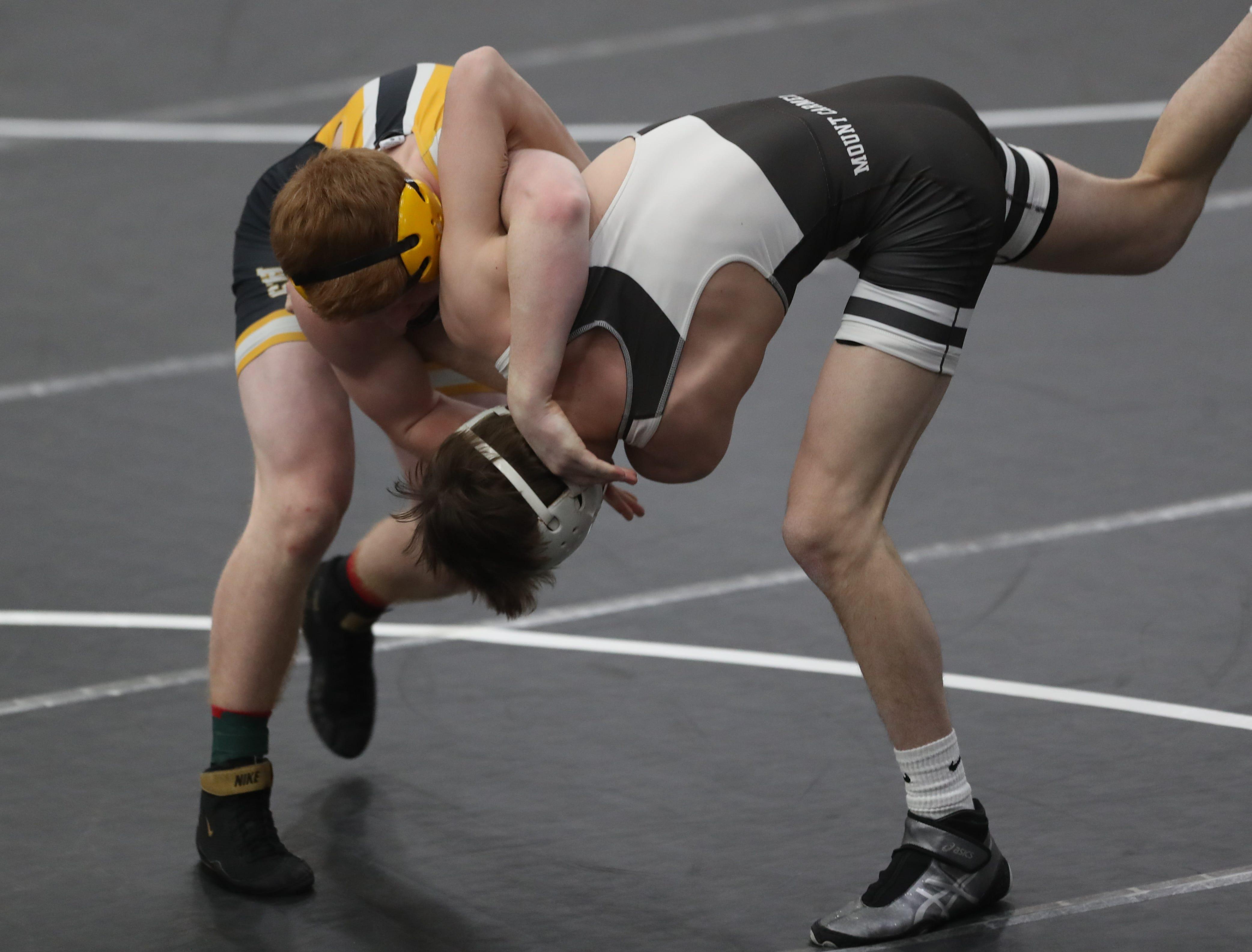 Ryan Strickland, of Southeast Polk High, wrestles at the Cheesehead Invitational at Kaukauna High School in Kaukauna, Wisconsin, on Jan. 5, 2019.