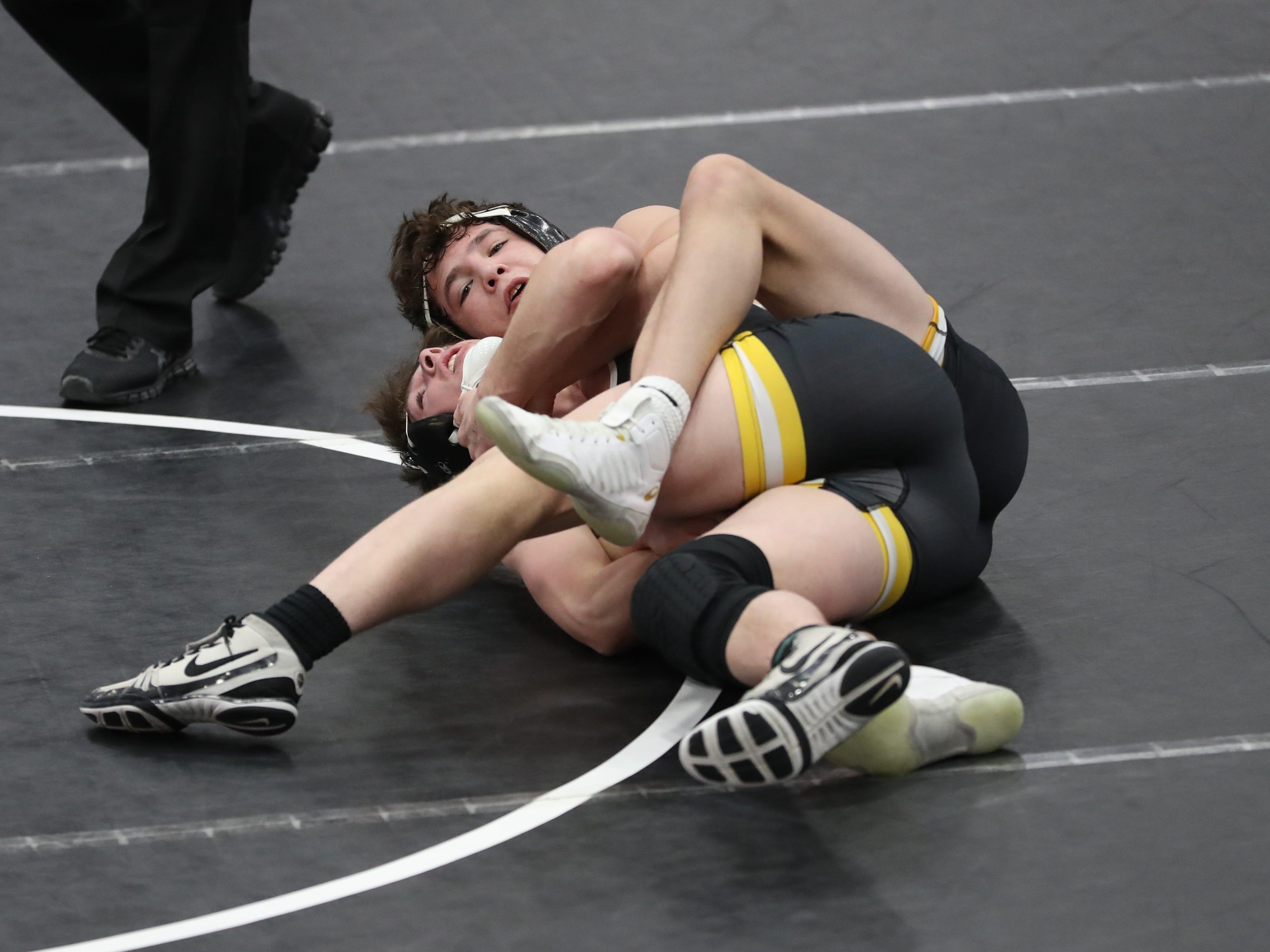 Cade DeVos, of Southeast Polk High, wrestles at the Cheesehead Invitational at Kaukauna High School in Kaukauna, Wisconsin, on Jan. 5, 2019.