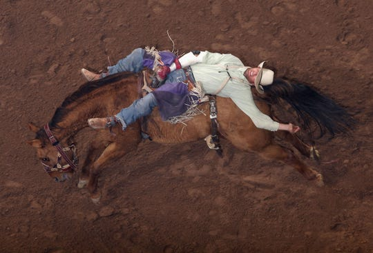 Bareback riding at the World's Toughest Rodeo in 2009 in Glendale, Ariz.