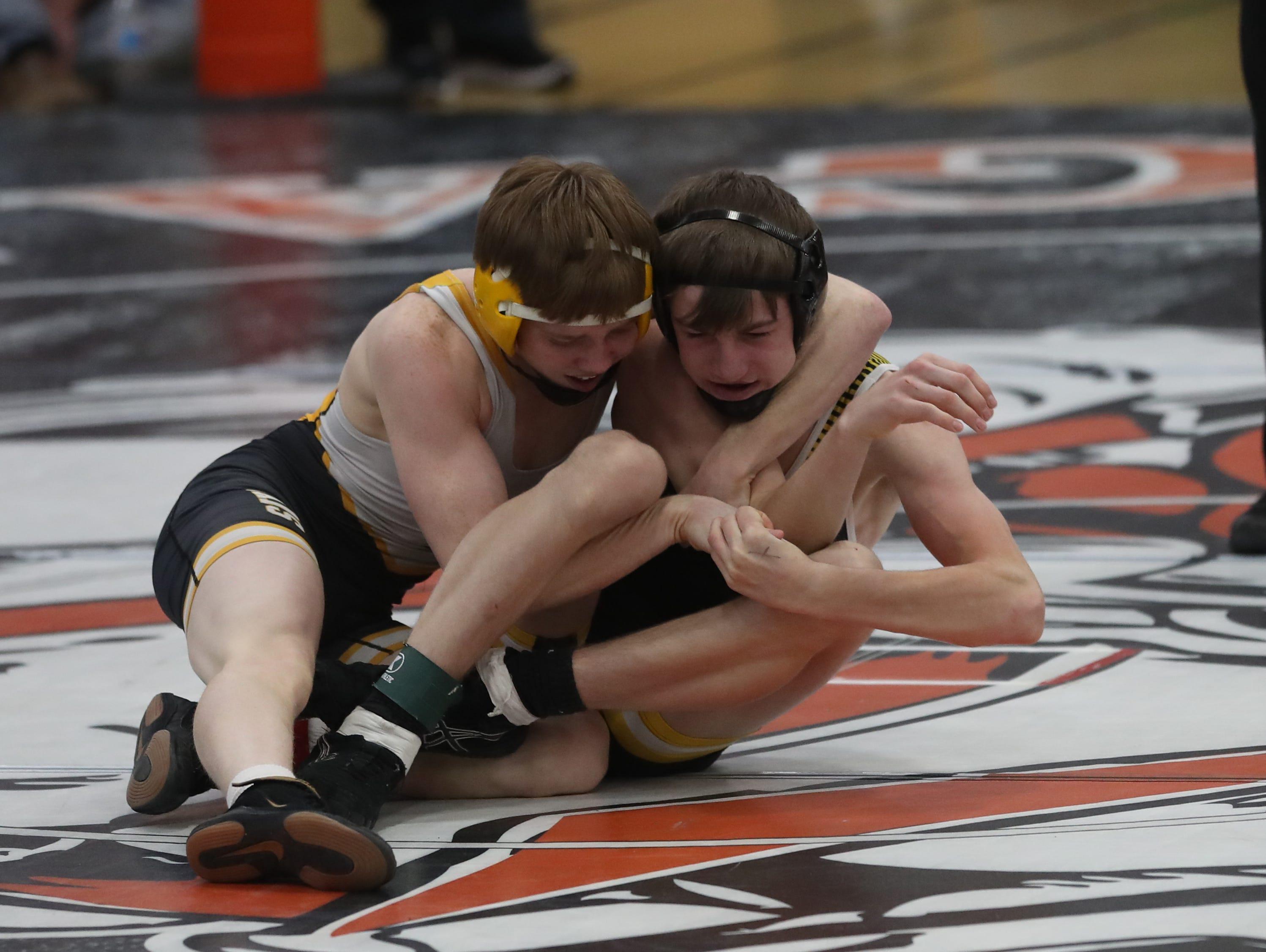 Devin Harmison, of Southeast Polk High, wrestles at the Cheesehead Invitational at Kaukauna High School in Kaukauna, Wisconsin, on Jan. 5, 2019.