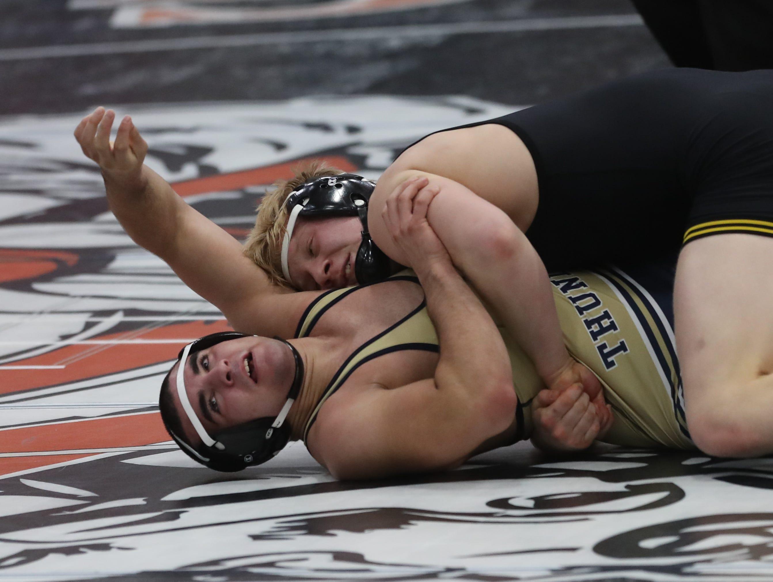 Gabe Christenson, of Southeast Polk High, wrestles at the Cheesehead Invitational at Kaukauna High School in Kaukauna, Wisconsin, on Jan. 5, 2019.