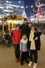 The Abbas family, of Northville, poses for a photo in Campus Martius in Detroit.