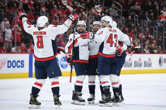 Washington Capitals' Alex Ovechkin (8) celebrates the winning goal by Michal Kempny (6) in the third period of the 3-2 win over the Detroit Red Wings at Little Caesars Arena, Jan. 6, 2019.