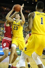 Michigan forward Brandon Johns Jr. scores against Indiana forward Clifton Moore during the second half on Sunday, January 6, 2019 at Crisler Center in Ann Arbor.
