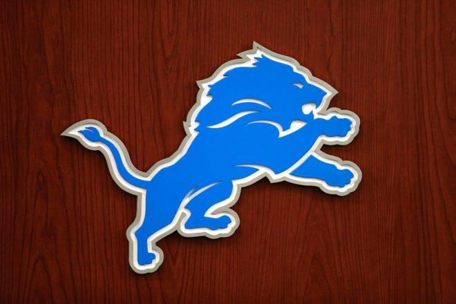 Detroit Lions logo on the podium in Allen Park, June 5, 2018.