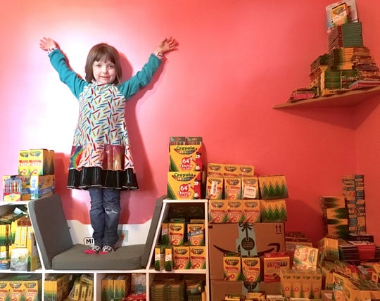 Brooklyn Brown, 5, stands in her Huntington Woods bedroom surrounded by the crayons she has collected for sick children. She has juvenile rheumatoid arthritis and wanted to do something to help other children who also have experienced the boredom that comes with hospitalization.