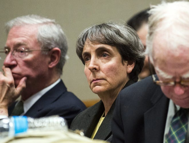 In this March 13, 2017, file photo, Liane Shekter Smith, former chief of the Michigan Department of Environmental Quality Office of Drinking Water, listens as a judge in Flint, Mich., denies motions to dismiss charges against five Department of Environmental Quality defendants related to the Flint water crisis.