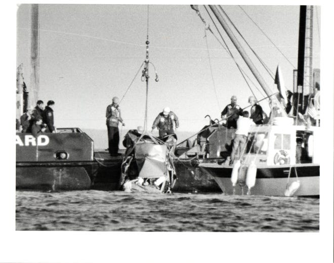 Rescuers, including the Coast Guard, work to recover the car and remains of Leslie Ann Pluhar, which plunged off of the Mackinac Bridge on Sept. 22, 1989.
