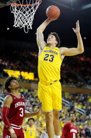 Michigan forward Brandon Johns Jr. scores against Indiana forward Justin Smith during the second half Jan. 6, 2019 at Crisler Center in Ann Arbor.
