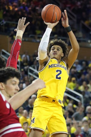 Michigan guard Jordan Poole scores against Indiana during the second half on Sunday, January 6, 2019 at Crisler Center in Ann Arbor.