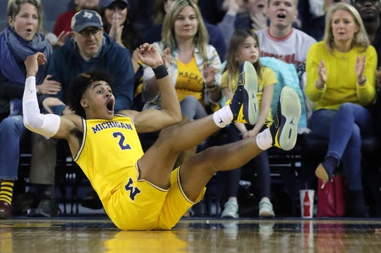 Jordan Poole reacts after being called for a foul during the second half on Sunday.