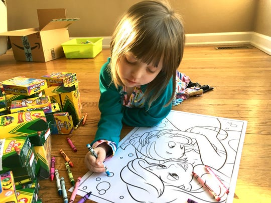 A child colors a picture in this USA Today file photo.