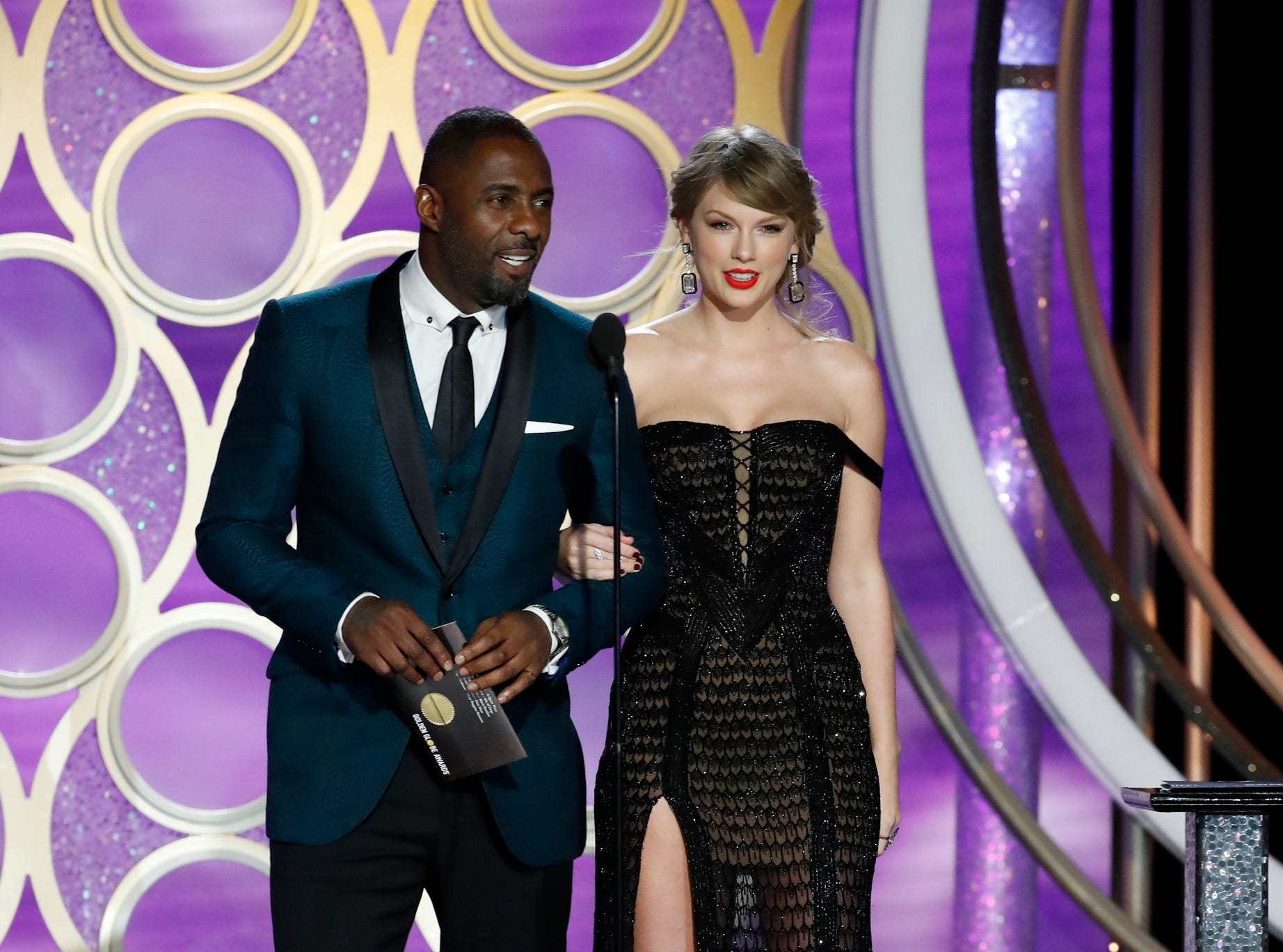 This image released by NBC shows presenters Idris Elba and Taylor Swift during the 76th Annual Golden Globe Awards at the Beverly Hilton Hotel.