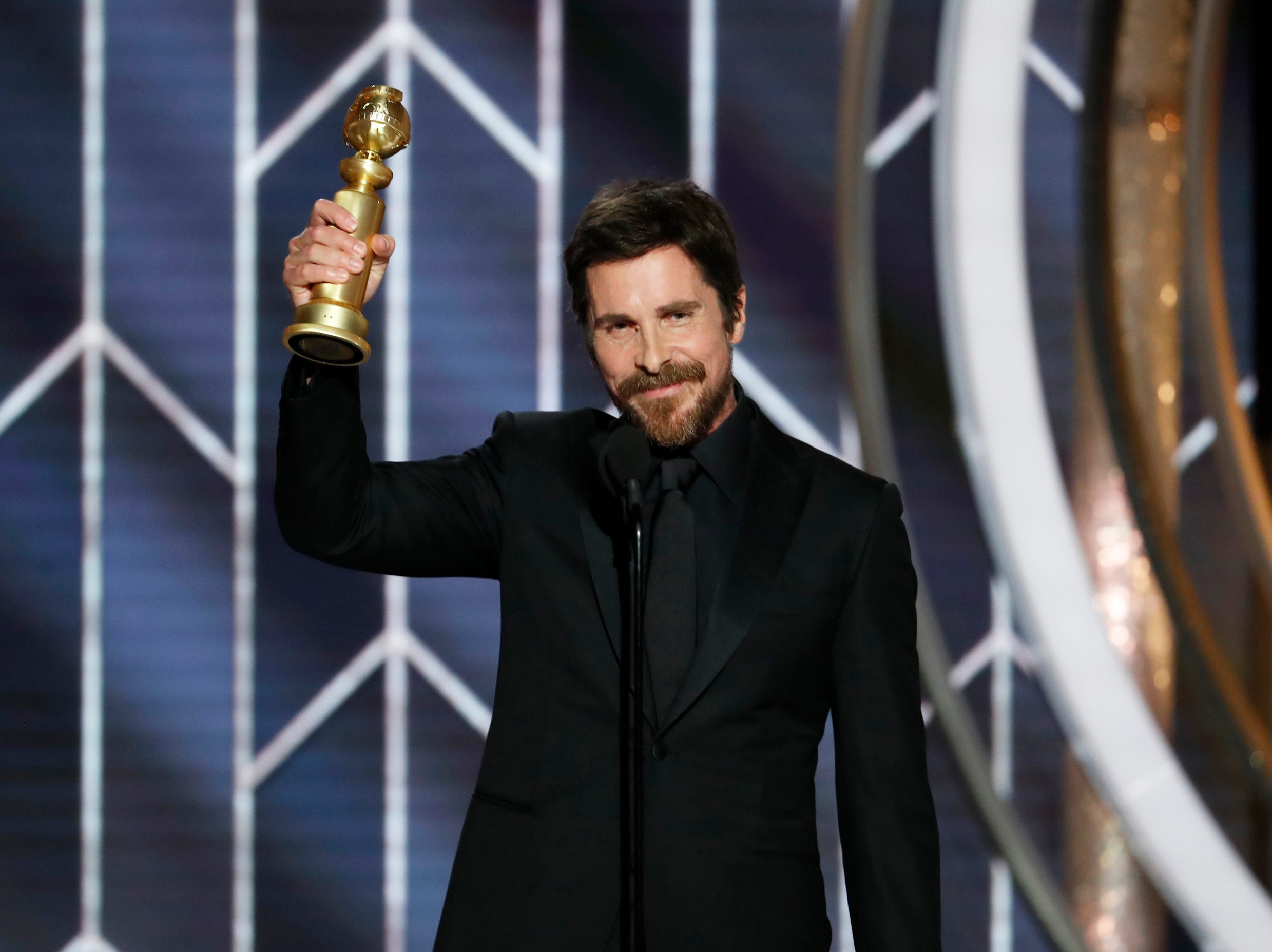 "This image released by NBC shows Christian Bale accepting the award for best actor in motion picture musical or comedy for his role in ""Vice"" during the 76th Annual Golden Globe Awards at the Beverly Hilton Hotel."