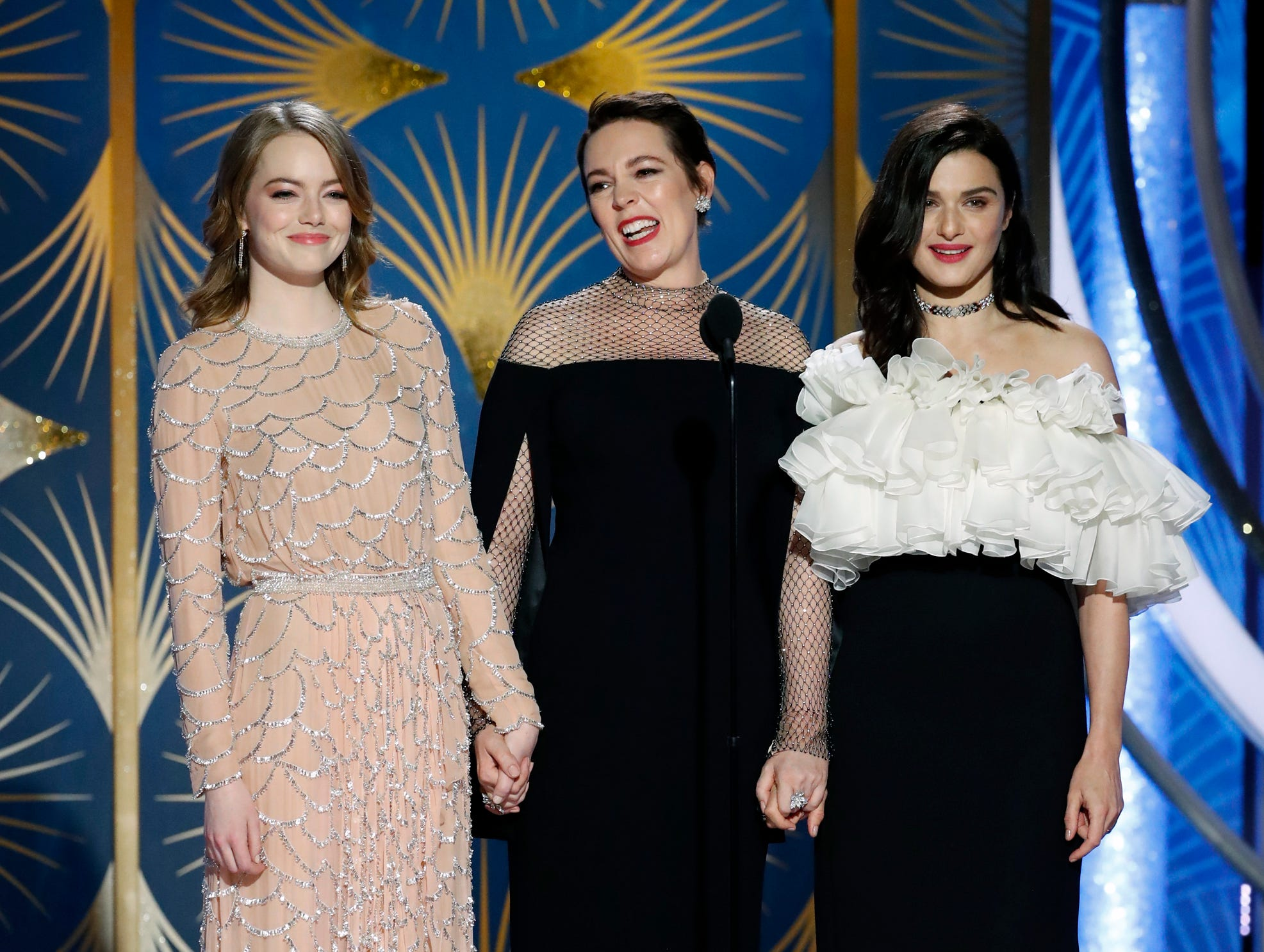 This image released by NBC shows presenters Emma Stone, from left, Olivia Colman, Rachel Weisz during the 76th Annual Golden Globe Awards at the Beverly Hilton Hotel.