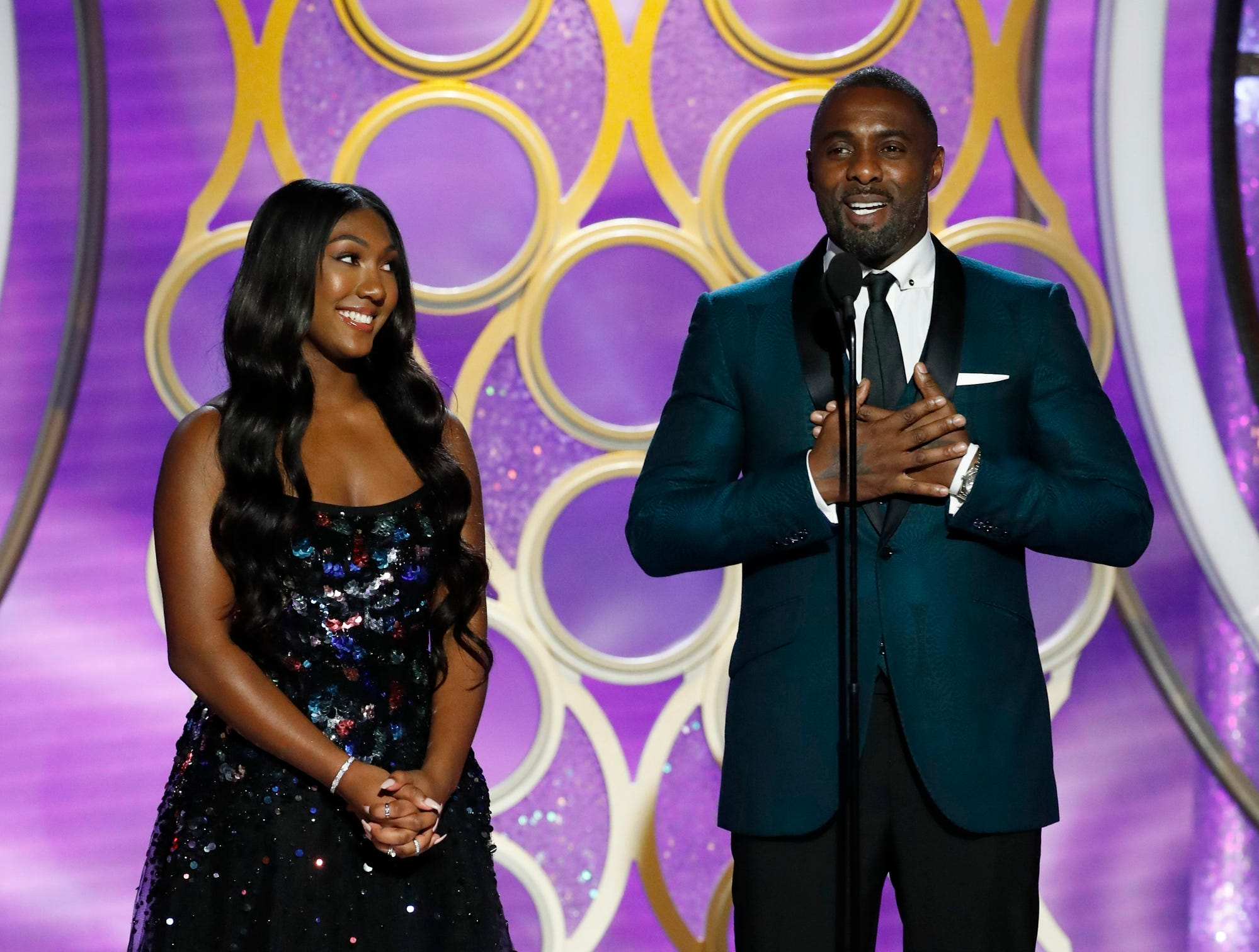 This image released by NBC shows Isan Elba, left, with her father, actor Idris Elba during the 76th Annual Golden Globe Awards at the Beverly Hilton Hotel.