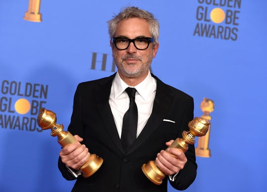 "Alfonso Cuaron poses in the press room with the awards for best director, motion picture and best motion picture, foreign language for ""Roma"" at the 76th annual Golden Globe Awards at the Beverly Hilton Hotel."