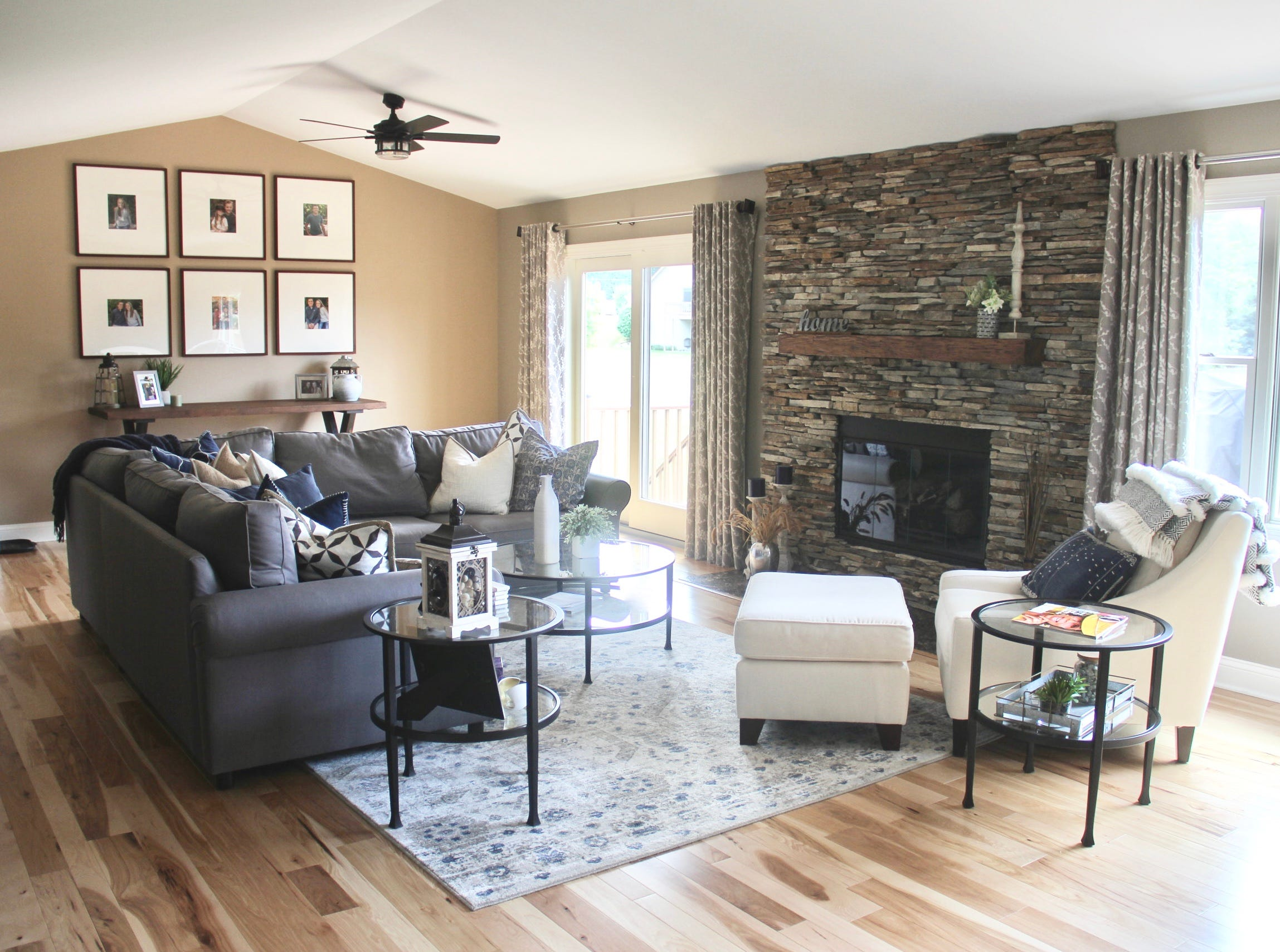 What was once a tall bare wall in this great room has become a focal point, which Sarah Macklem says can easily be achieved with a budget of around $500. All it takes is a console, a gallery wall of family photos and some decorative accessories.