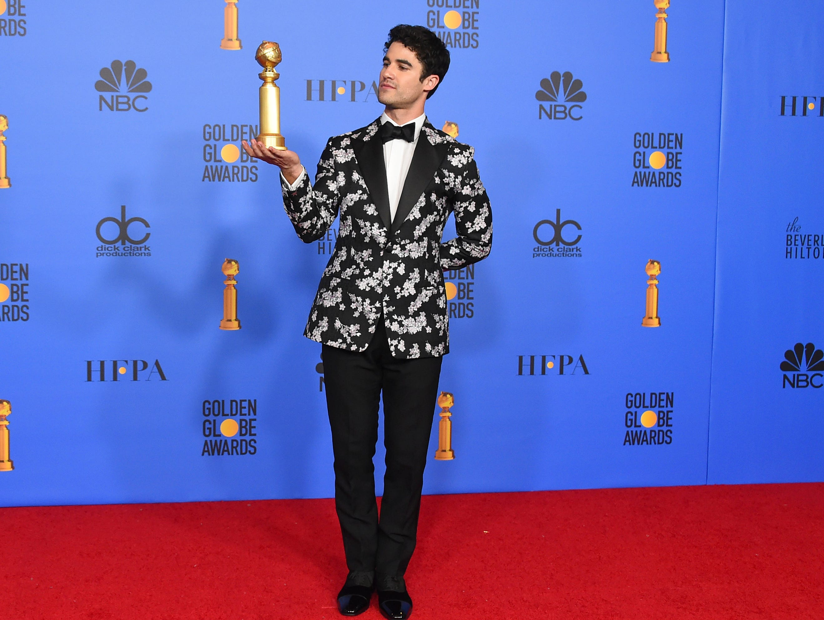 "Darren Criss poses in the press room with the award for best performance by an actor in a limited series or a motion picture made for television for ""The Assassination of Gianni Versace: American Crime Story"" at the 76th annual Golden Globe Awards at the Beverly Hilton Hotel."