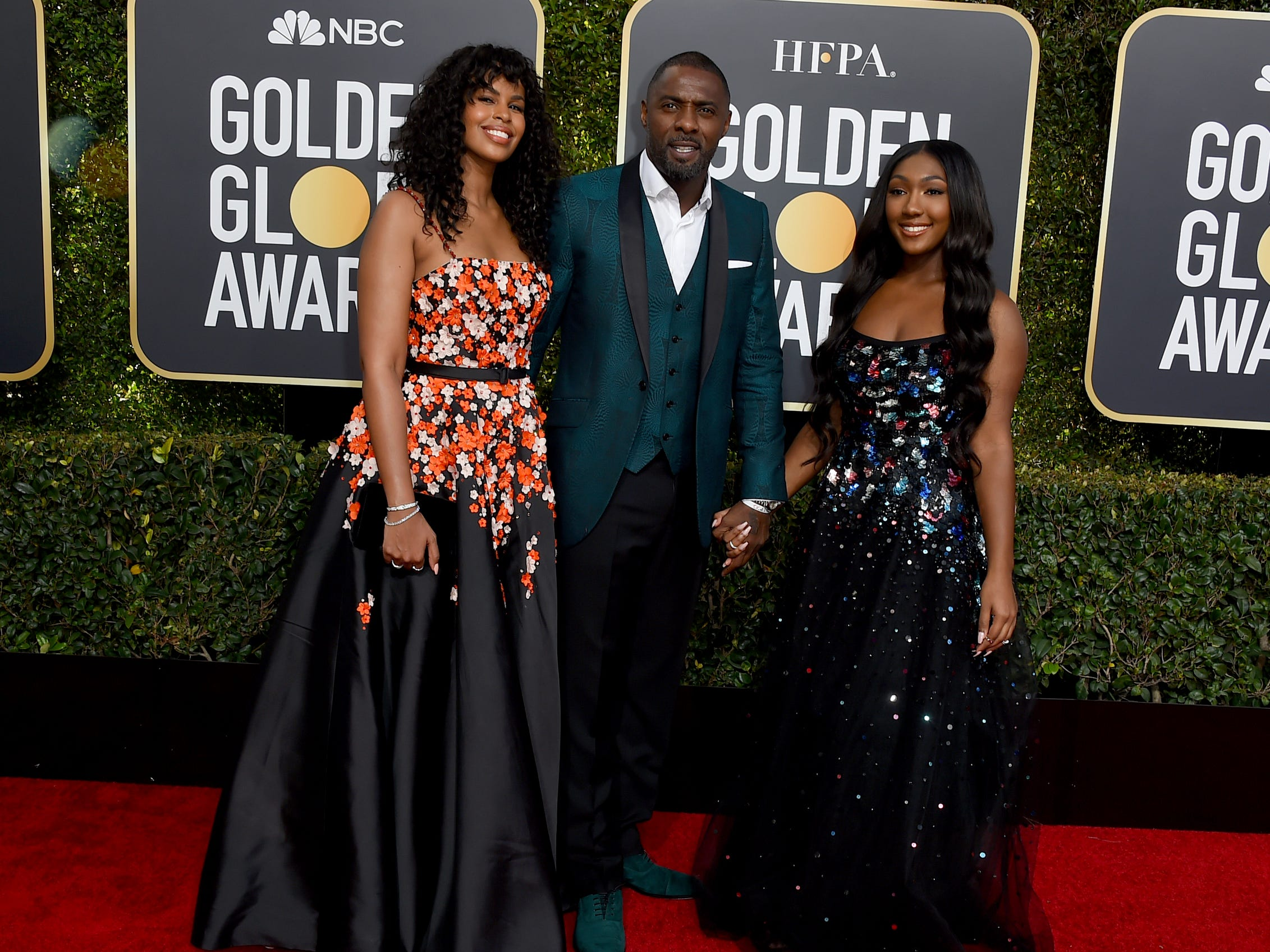 Idris Elba, center, his daughter Isan Elba, right, and Sabrina Dhowre arrive at the 76th annual Golden Globe Awards at the Beverly Hilton Hotel on Sunday, Jan. 6, 2019, in Beverly Hills, Calif.