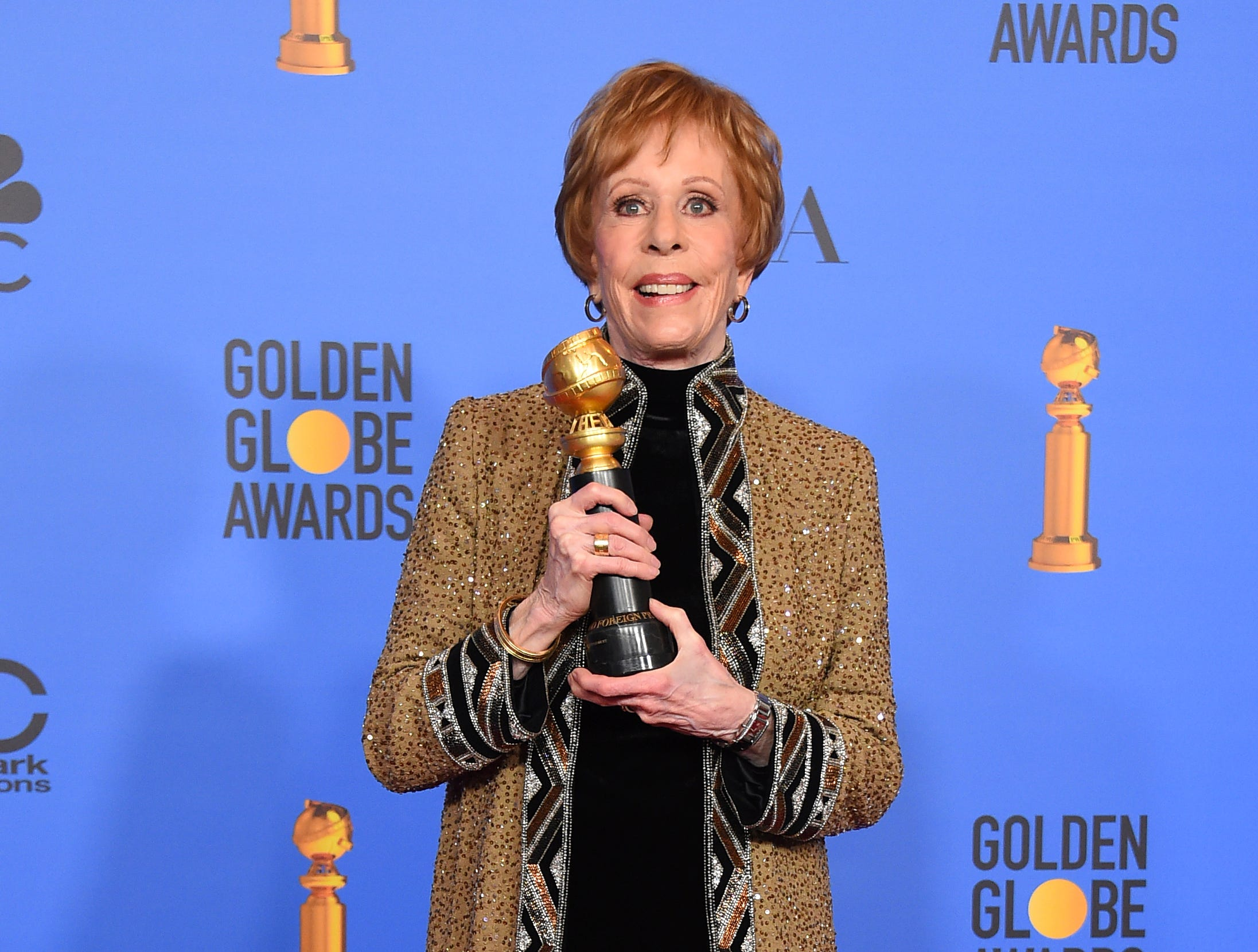 Carol Burnett poses in the press room with the inaugural Carol Burnett Award at the 76th annual Golden Globe Awards at the Beverly Hilton Hotel.