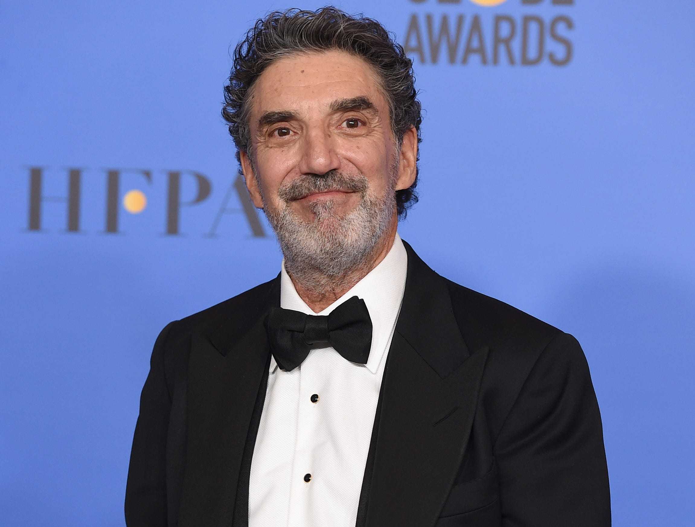 "Chuck Lorre poses in the press room with the award for best television series, musical or comedy for ""The Kominsky Method"" at the 76th annual Golden Globe Awards at the Beverly Hilton Hotel."