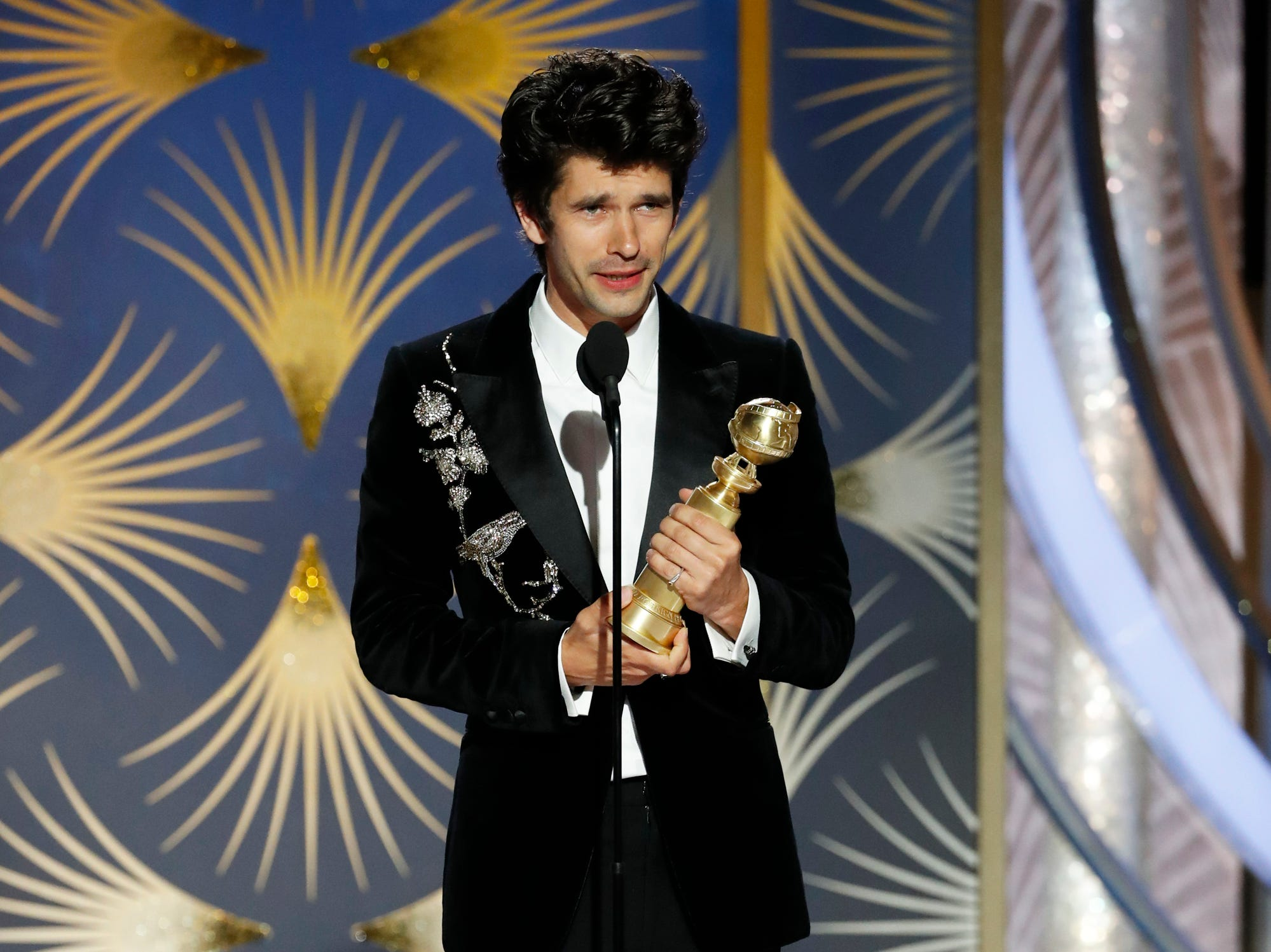 "This image released by NBC shows Ben Whishaw accepting the award for best supporting actor in a series, limited series or TV movie for his role in ""A Very English Scandal"" during the 76th Annual Golden Globe Awards at the Beverly Hilton Hotel."