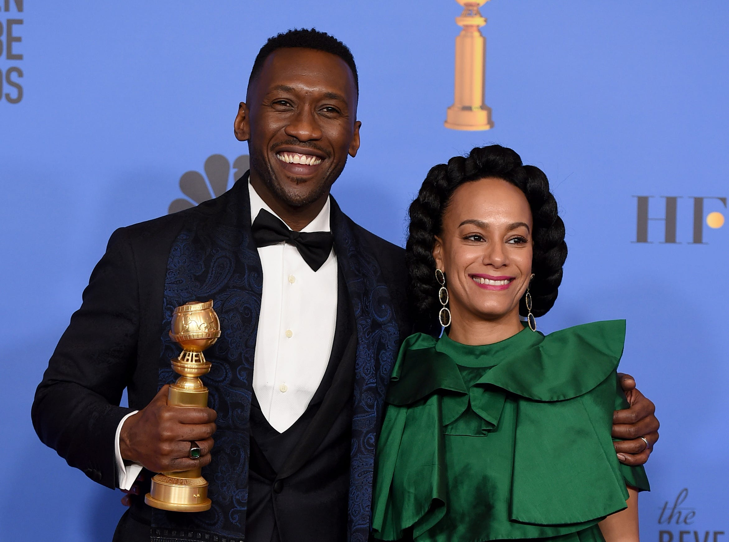 "Mahershala Ali, left, winner of the award for best performance by an actor in a supporting role in any motion picture for ""Green Book,"" and Amatus Sami-Karim pose in the press room at the 76th annual Golden Globe Awards."